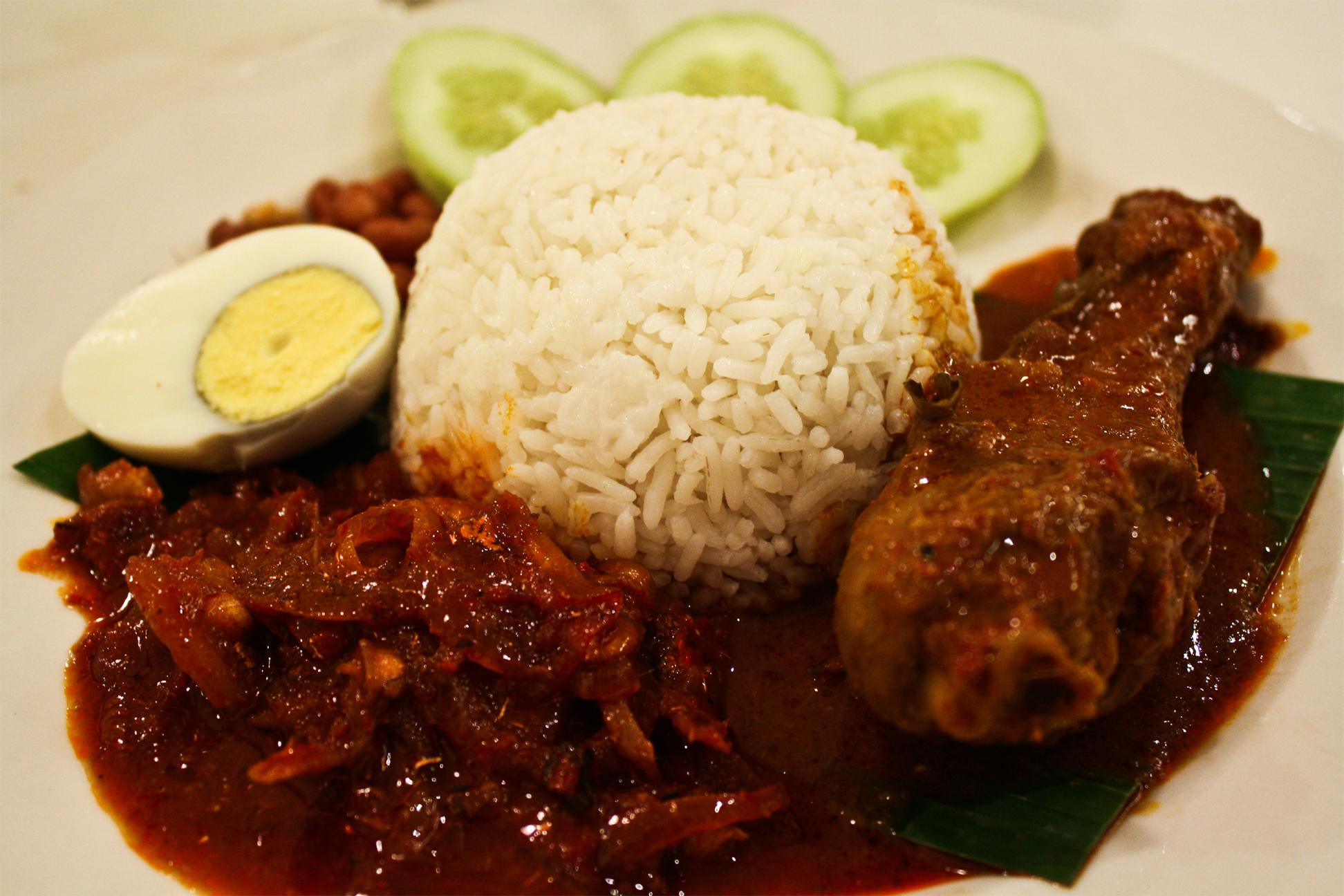 nasi lemak coconut milk sambal chili rich rice fried chicken cucumber singapore malaysia traditional hawker street food