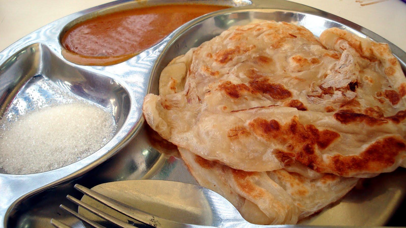 roti prata curry sugar flat bread dough plain egg singapore malaysia street food traditional hawker