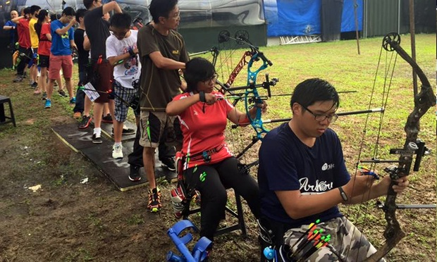 People doing archery