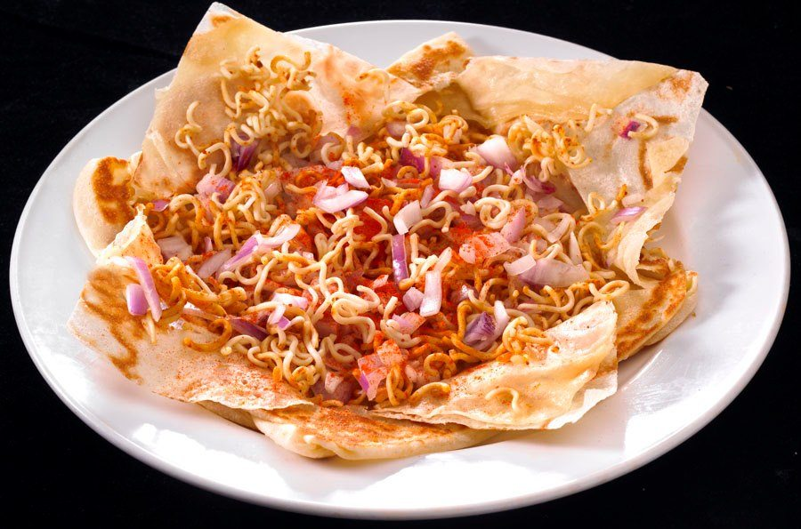 An unusual prata creation of maggie mee and onions