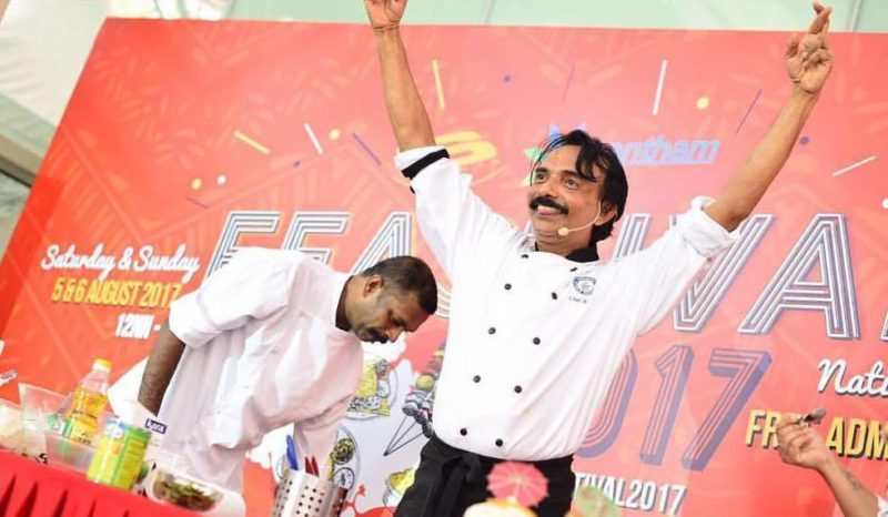 Chef throwing hands into the air out of joy at a LalooLalang contest