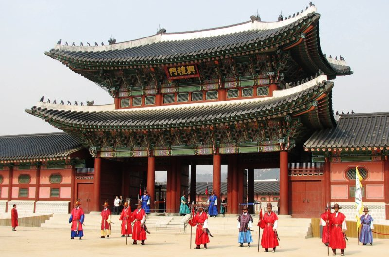 Gyeongbokgung Palace in Seoul with Royal Guards decked in traditional wear.