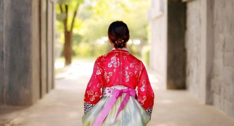 Woman wearing hanbok as she walks