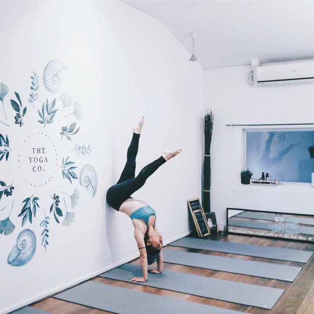 Founder of Yoga Co posing at the Yoga Co Studio