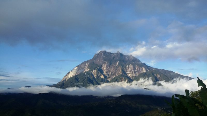 Mount Kinabalu against blue sky in Malaysia
