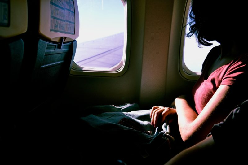 Girl sitted in an airplane looking out of the window