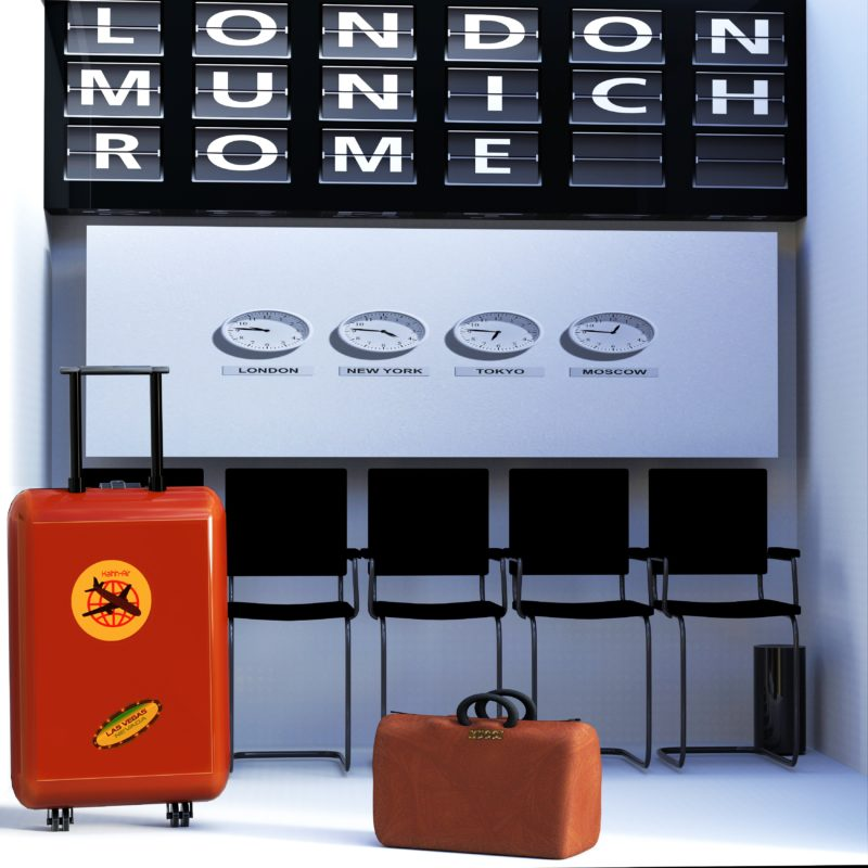 Luggage against wall with world clocks