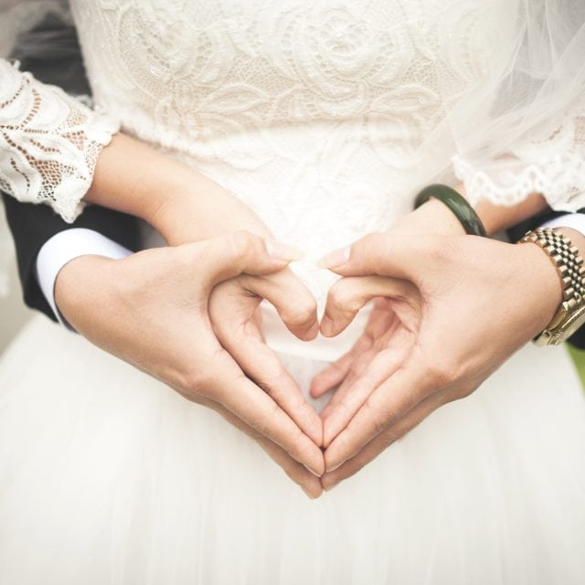 couple hands heart shape wedding