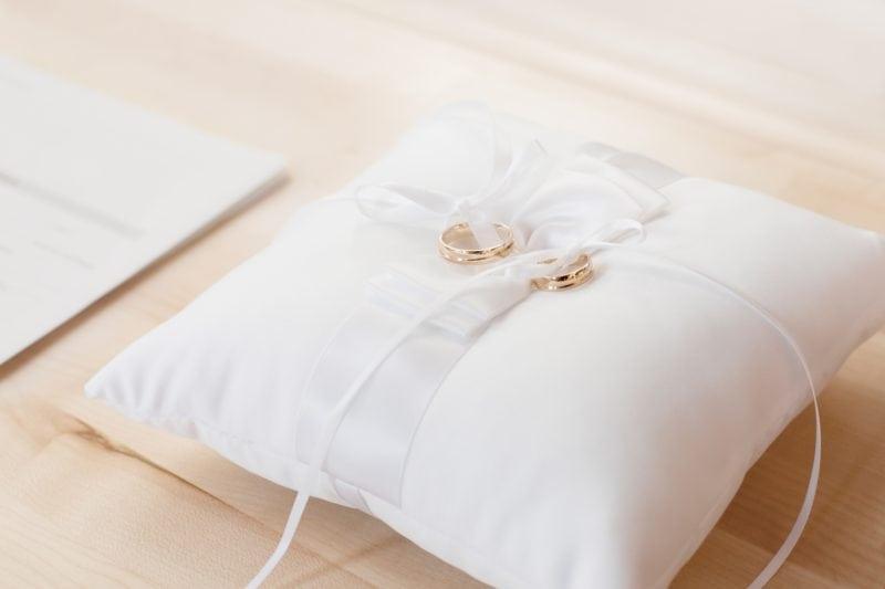 Wedding rings on white cushion