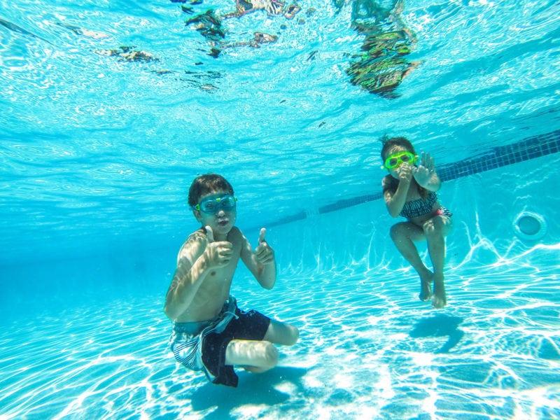 Kids swimming under water