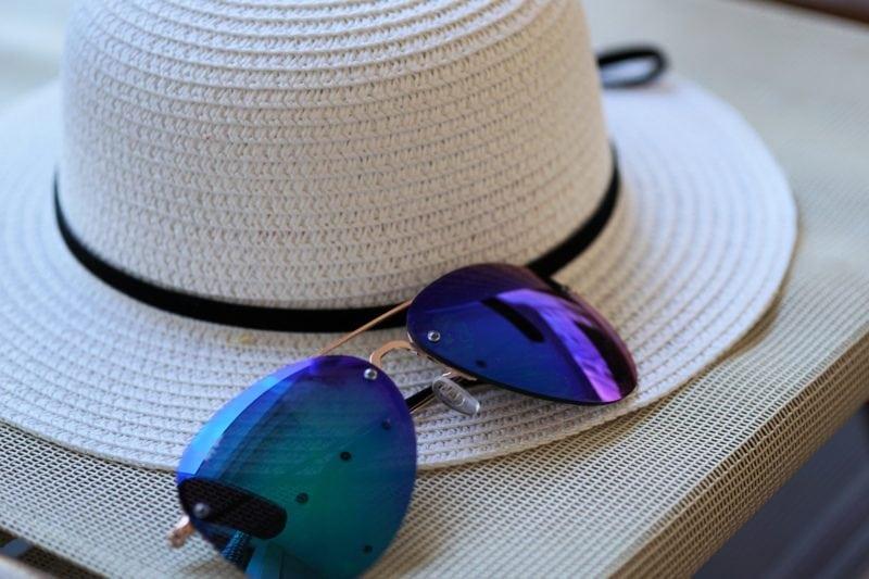 Sun hat and sun glasses