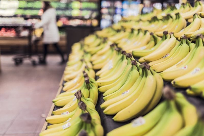 Bananas and groceries in supermarket