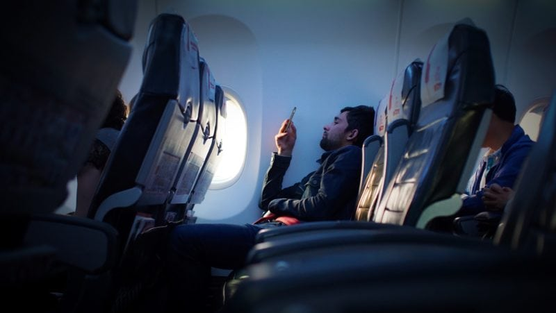 Man seated in the plane
