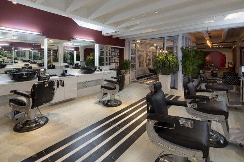 Interiors of Jermyn Street barbershop with chairs and line patterned floor