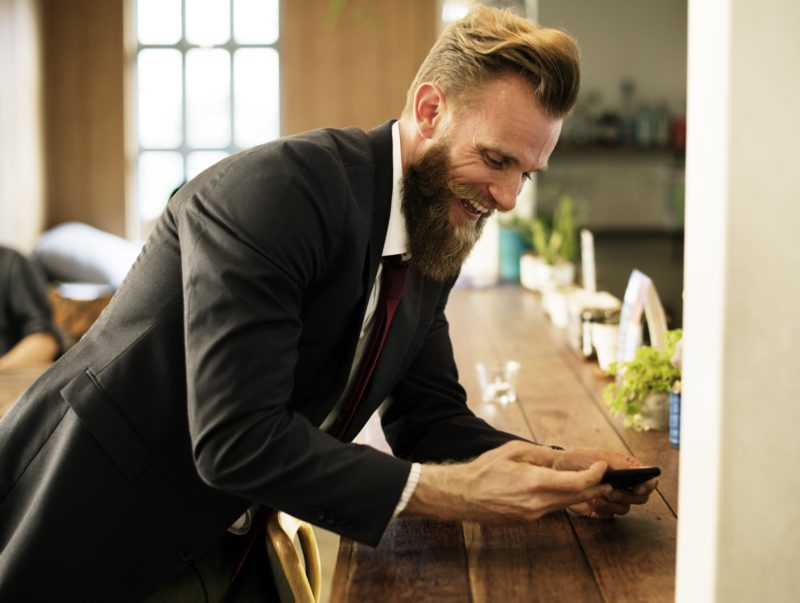 Bearded man with smartphone