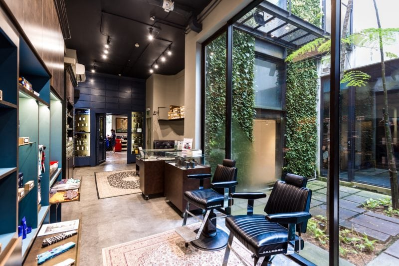 Sultans of Shave barber Shop interiors with window that opens to green landscapes