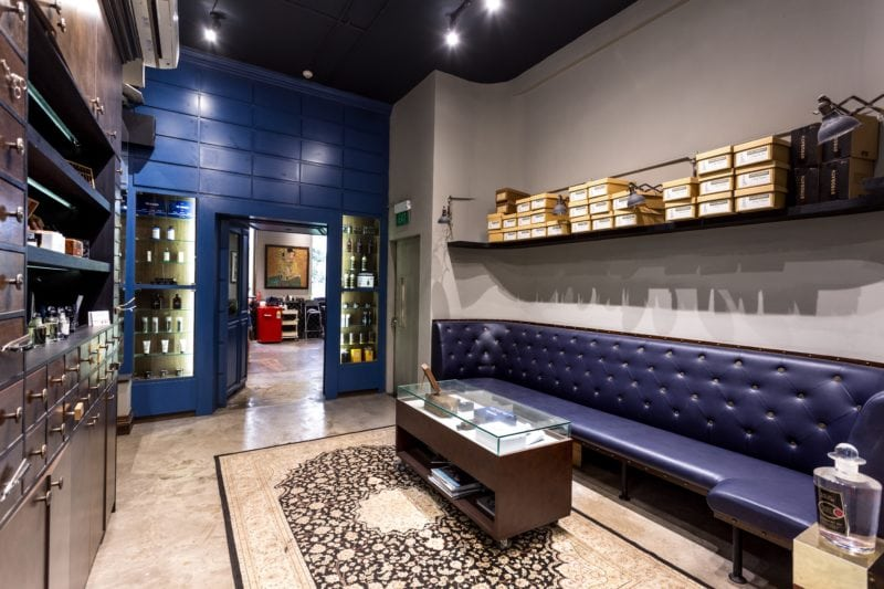 Lush Sultans of Shave shop interiors with leather settee and blue wall at background