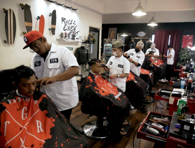 The Golden Rule Barber Co. Crew at work with clients on every chair