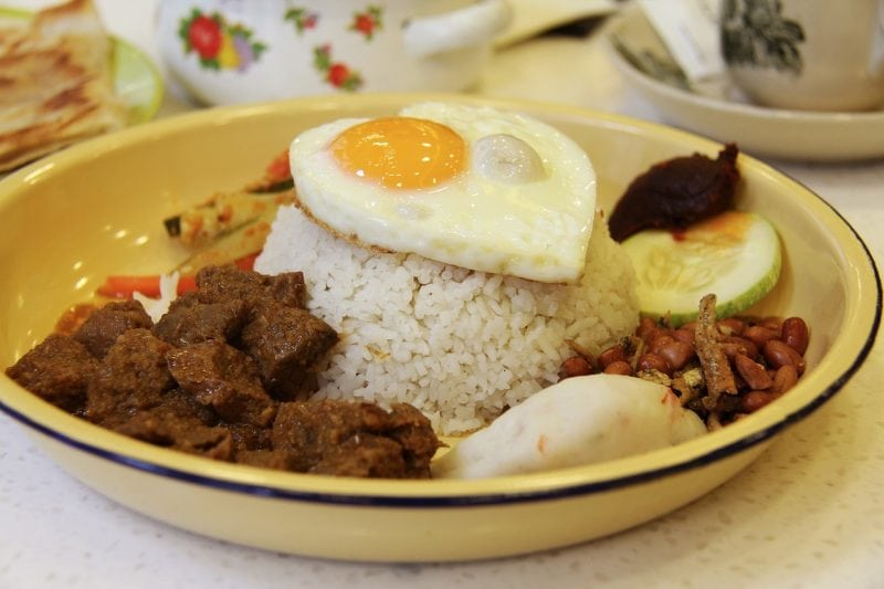 Delicious plate with rendang and nasi