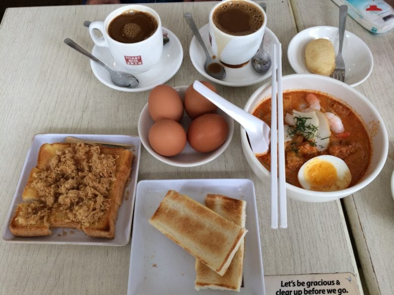 Platter of egg toast with. 2 cups of coffee