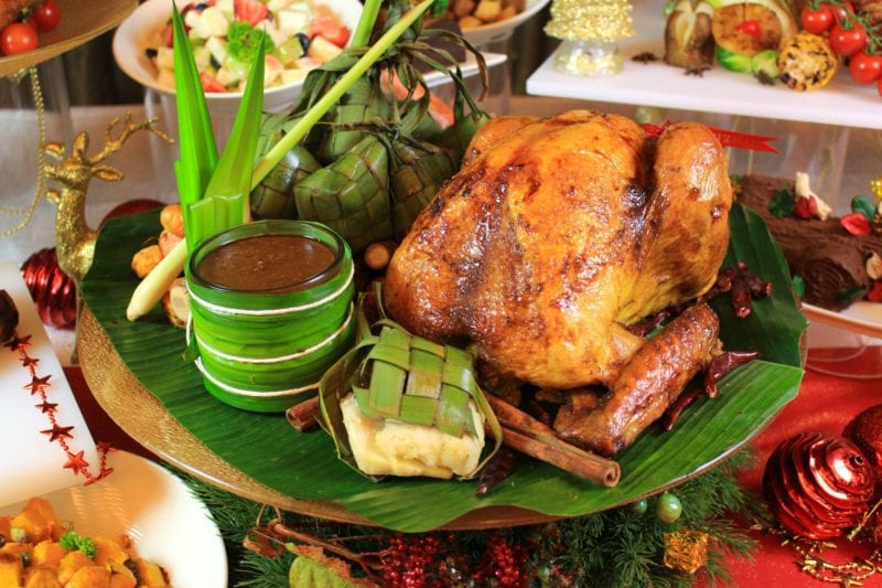 roast turkey with satay sauce on green leaf plate