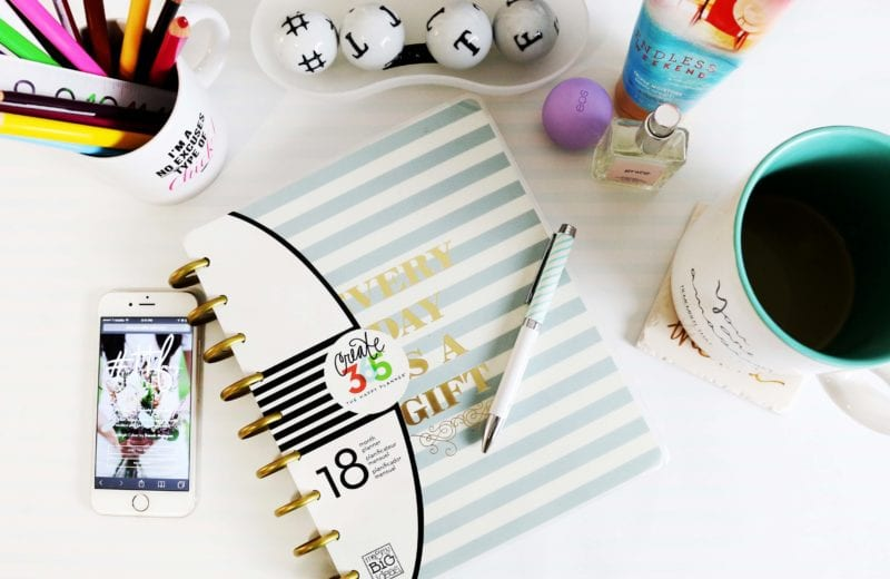 memo pad with pen across it and stationery all on table