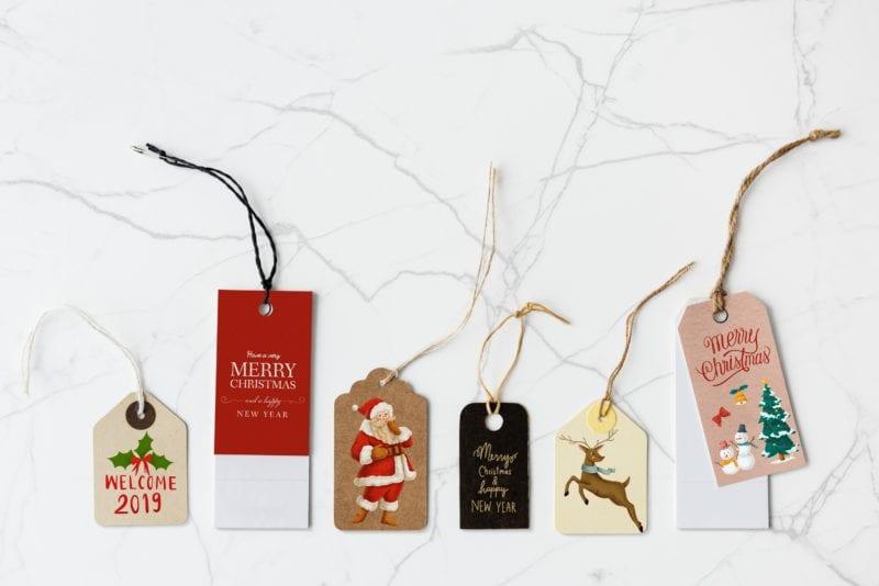 Christmas tags on white top
