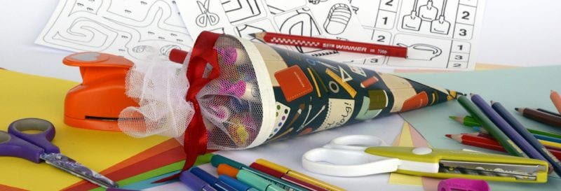 gift bag of stationery with pens on table