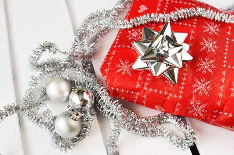 red gift wrapped with silver bow