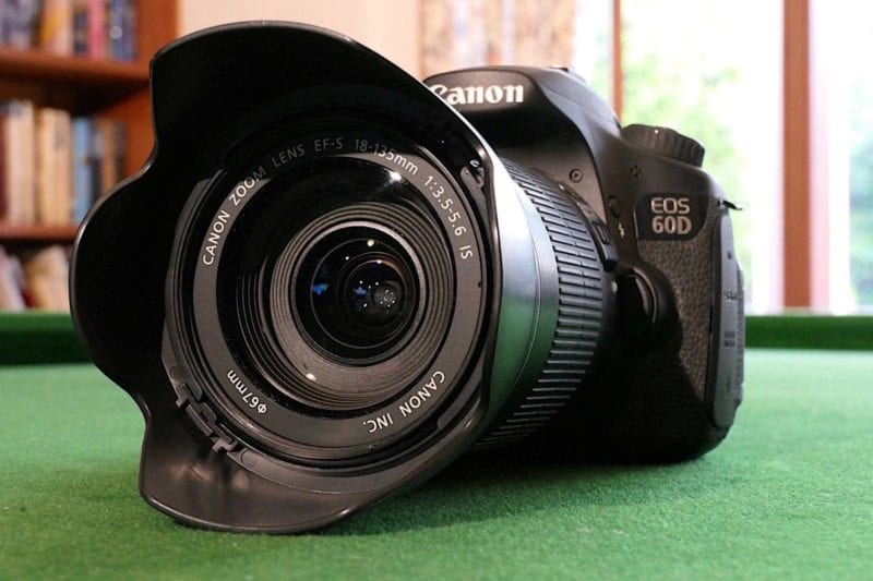 Canon EOS 60D camera on green tabletop