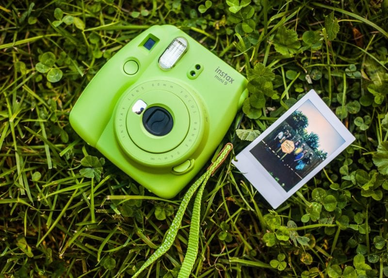 Fujifilm Instax Mini in green with instant print lying in grass