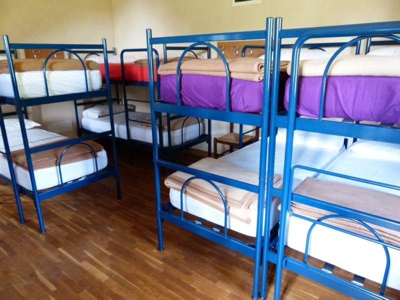 bunk beds in dorm on brown wooden floor