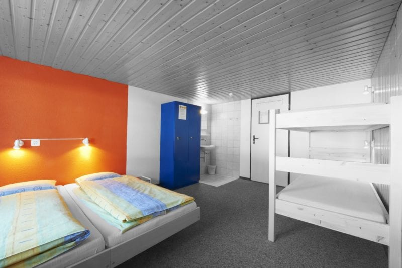 private room in hostel with bunk bed on side