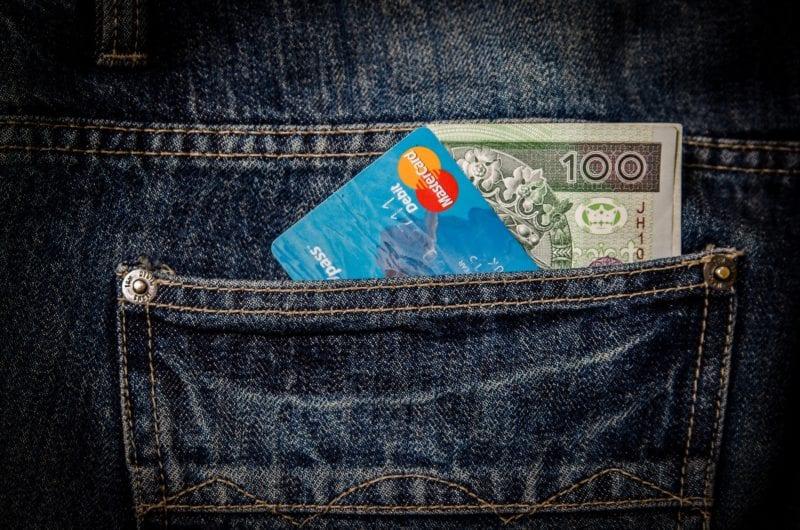 money and card in back denim pocket