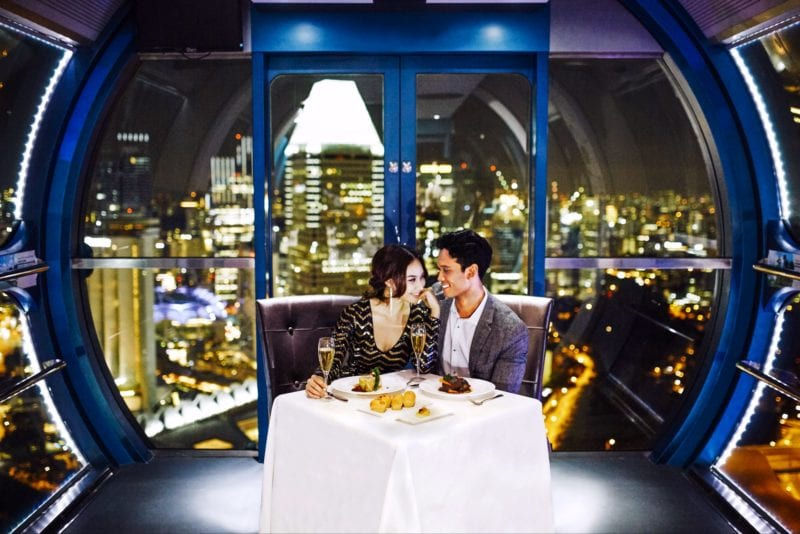 couple in capsule of Singapore Flyer dining