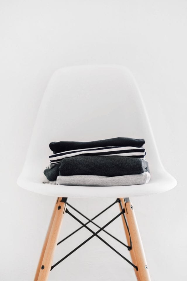 black clothes on white chair