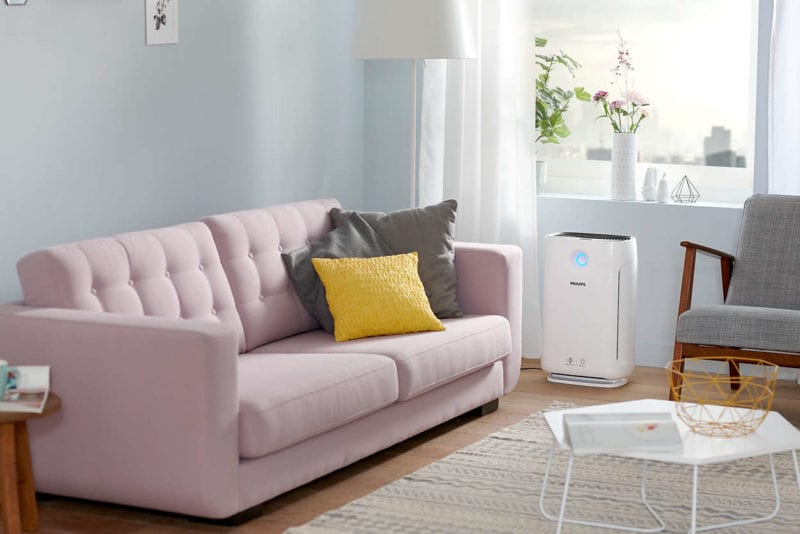 Philips air purifier in a living room with pink sofa