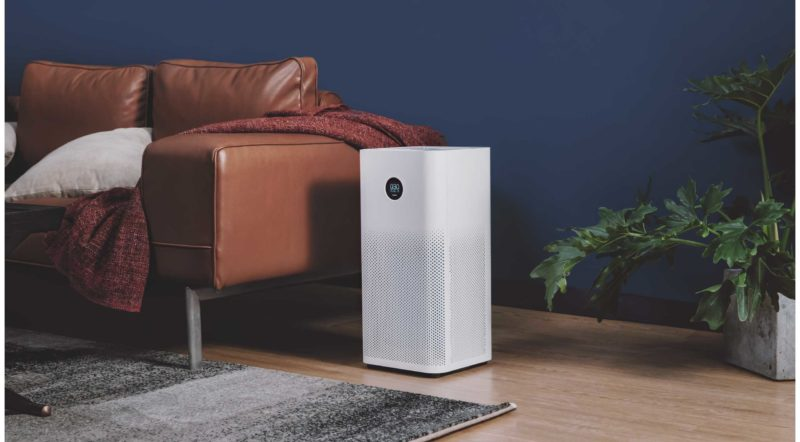 air purifier beside brown leather sofa