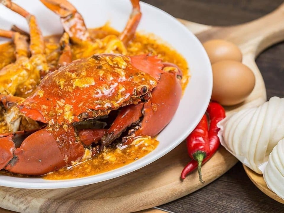 chilli crab with egg and chili peppers