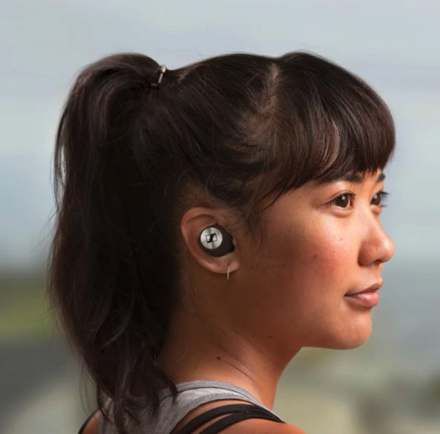 lady wearing Sennheiser true wireless bluetooth earbuds
