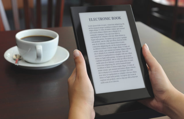 ebook on kindle with cup of coffee