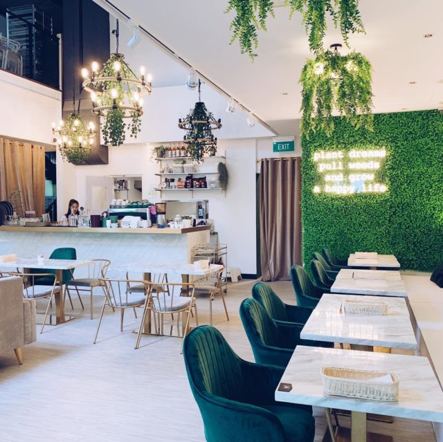 green and white layout of a cafe with neon lightings