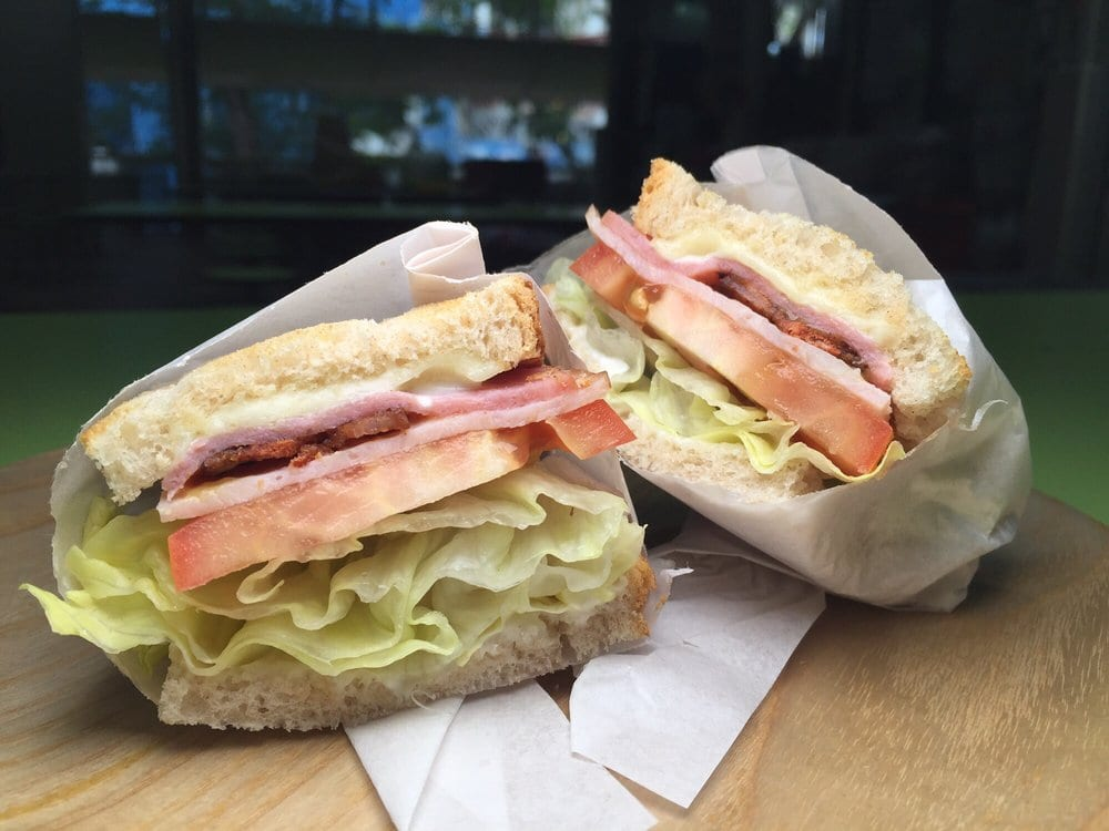 sandwich with tomato, lettuce, bacon and cheese
