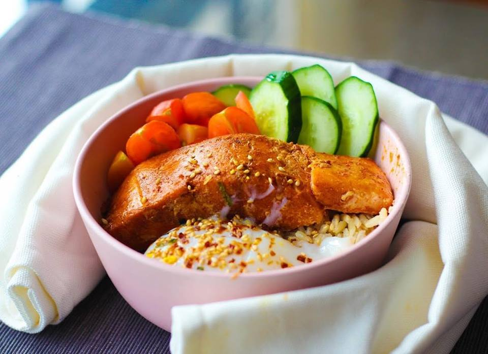 grilled salmon rice bowl with cherry tomatoes and zucchini