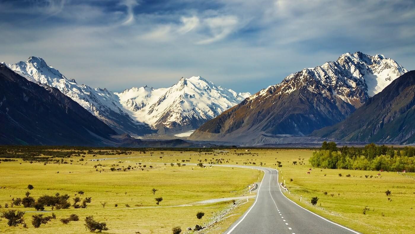 road leading to mountains range