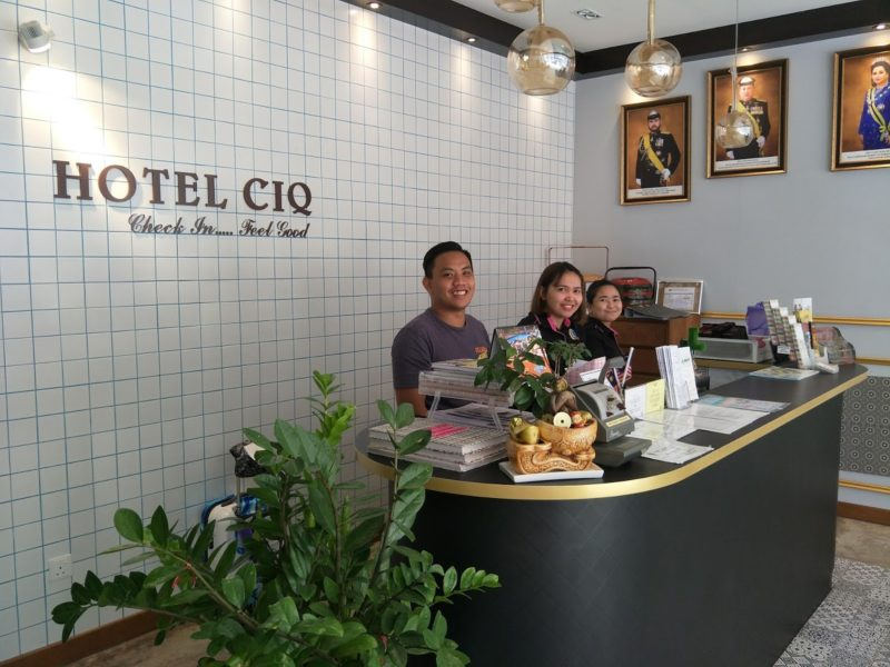 Front lobby of Hotel CIQ with 3 friendly crew at front desk