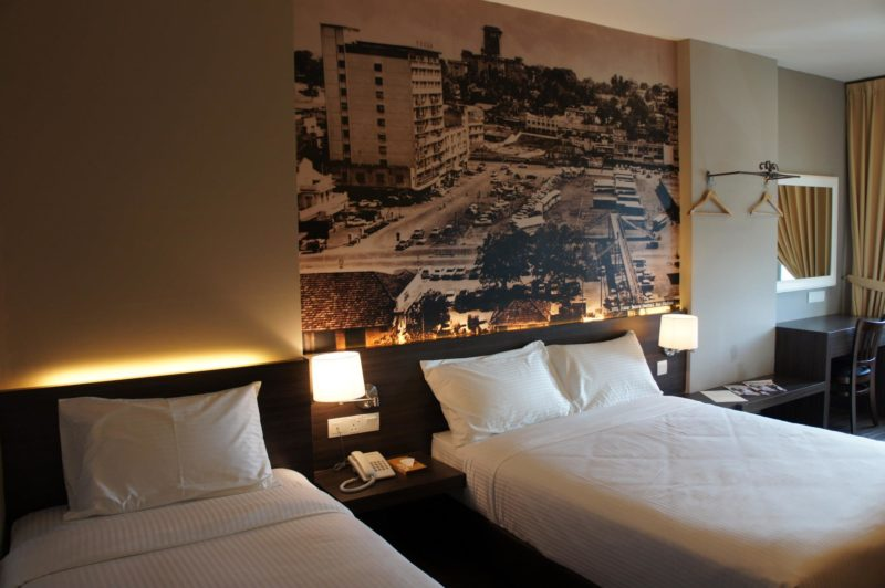 Twin room with double beds at hotel and JB heritage wall picture at back
