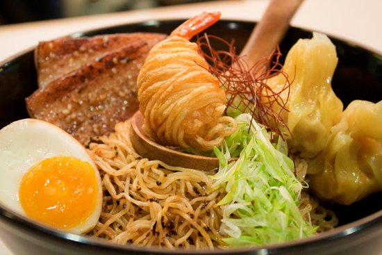 chinese style noodles with dumplings, pork belly and half-boiled egg