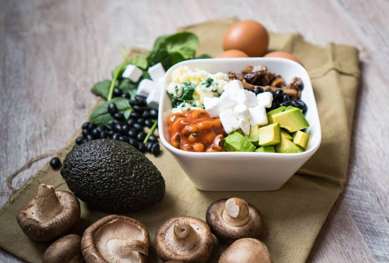 salad bowl with feta cheese, mushroom, kale, olives