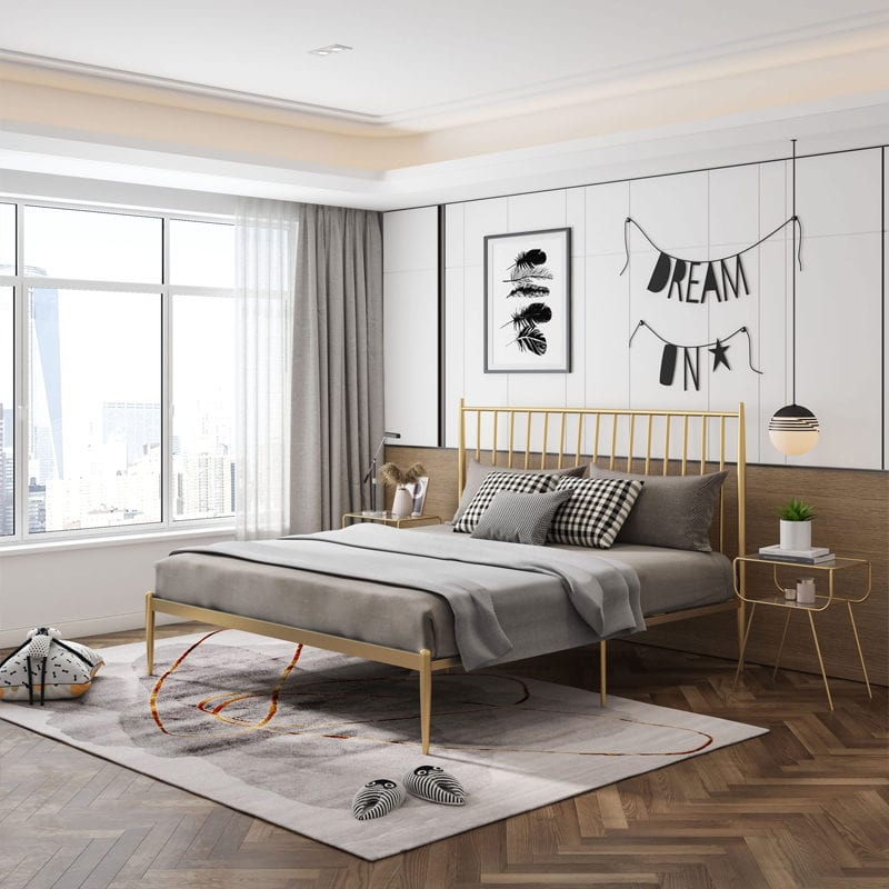 bedroom with gold iron bed frame